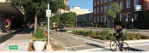 A streetscape with a protected bike lane on the left and car lanes on the right